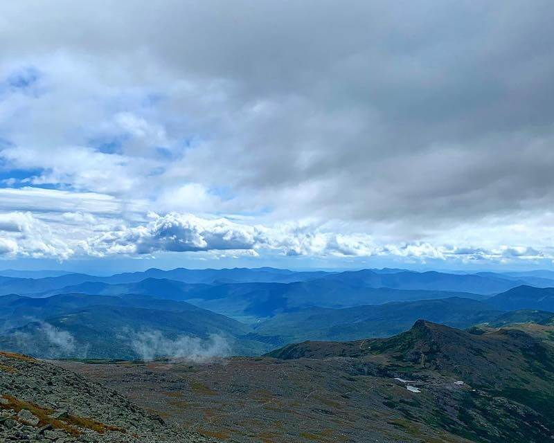 View of Mountains and clouds as seen from top of Mount Washington
